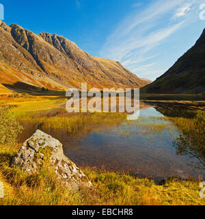 Loch Achtriochtan in Glen Coe. Part of the Aonach Eagach ridge is in the background. - Stock Photo