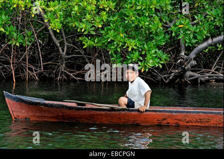 young boy fishing in Isla Bastimentos National Marine Park Bocas del Toro Archipelago Republic of Panama Central - Stock Photo