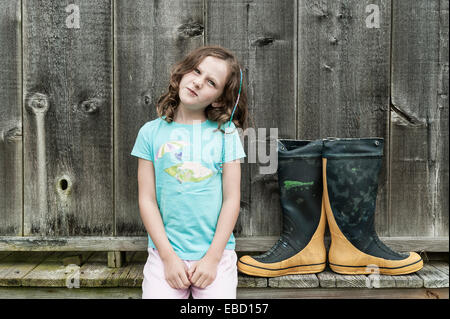 Girl posing with funny face, Cape Cod, Massachusetts - Stock Photo
