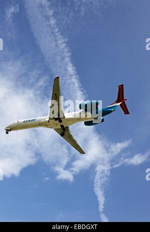 passenger jet liner landing in Geneva airport Geneva Switzerland Europe - Stock Photo