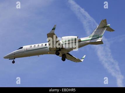 passenger jet liner landing in Geneva airport, Geneva, Switzerland, Europe - Stock Photo