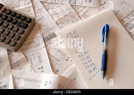 summary of household expenses by collected receipts from supermarkets - Stock Photo