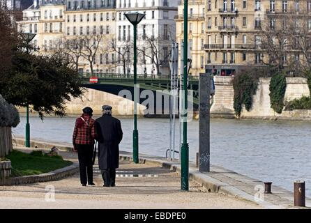 mature couple walking at promenade in Jardin Tino-Rossi, Gardens Tino-Rossi, Seine river banks, listed as World - Stock Photo