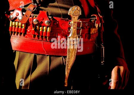 Traditional Arab dagger or khanjar of a Bedouin Desert Patrol policeman at the Treasury monument Al-Khazneh, UNESCO - Stock Photo