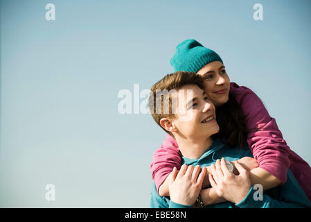Close-up portrait of teenage couple embracing outdoors, Germany - Stock Photo