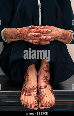 Close-up of Woman's Hands and Feet with Henna in Arabic Style - Stock Photo