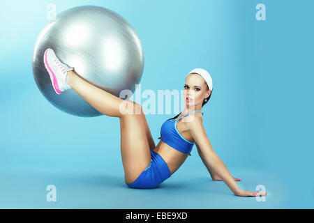 Training. Athletics. Woman in Sportswear with Fitness Ball - Stock Photo