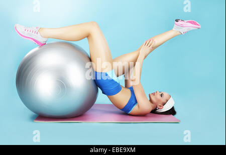 Wellness Concept. Woman in Sportswear with Sport Equipment - Stock Photo