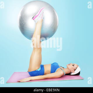 Gym. Wellness. Sporty Woman with Fitness Ball - Stock Photo