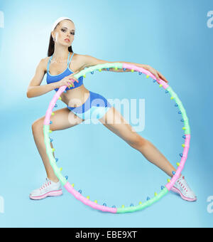 Gymnastics. Fit Woman with Hoop in Fitness Club - Stock Photo