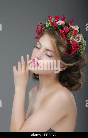 Sensuality. Luxurious Female with Classic Wreath of Flowers - Stock Photo