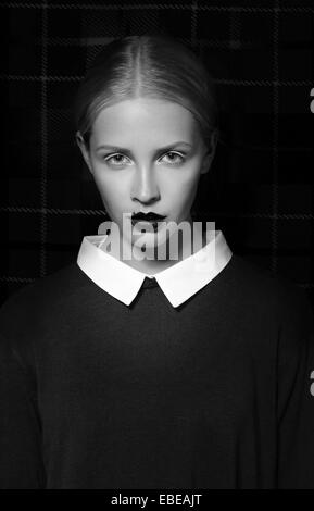 Studio Portrait of Strict Woman with White Collar - Stock Photo