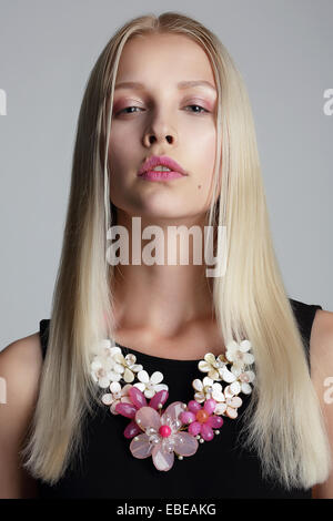 Long Hair Blonde with Vernal Garland on her Neck - Stock Photo