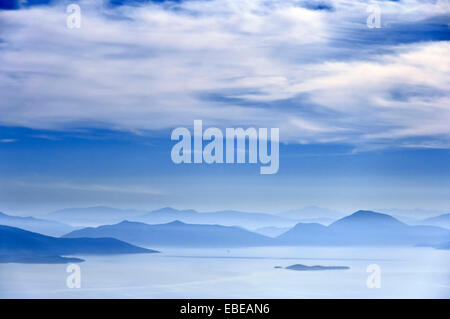 Pagasitic Gulf and the mountains of mainland Greece - Stock Photo