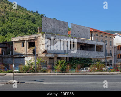 Old destroyed building after war in Mostar, Bosnia and Herzegovina. - Stock Photo