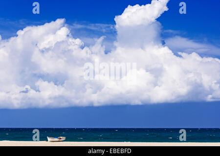 Boat lying on deserted beach - Stock Photo