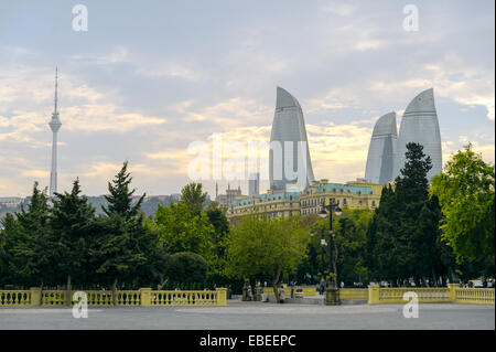 View of the Flame Towers skyscraper from caspian sea coastline in Baku Azerbaijan - Stock Photo