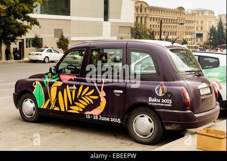London style city taxi with 2015 first European games advertisement in Baku, Azerbaijan. - Stock Photo