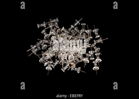 A closeup to a pile of drawing pins - Stock Photo