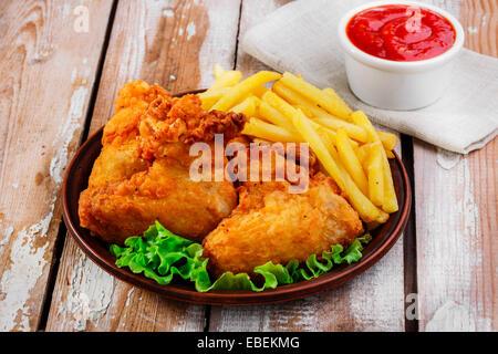 fried chicken wings in batter - Stock Photo