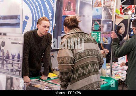 London, UK. 29th November, 2014. A customer discusses music with a seller of vinyl records at the Independent Label - Stock Photo