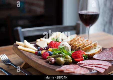 Charcuterie board and red wine - Stock Photo