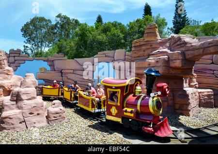 GOLD COAST, AUS -  NOV 06 2014:Visitors on Rideable miniature railway train in Movie World Gold Coast Queensland - Stock Photo