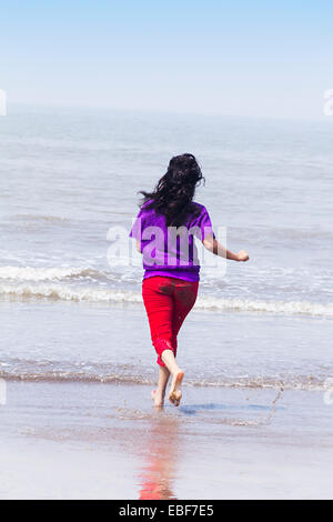 indian lady beach  Running - Stock Photo