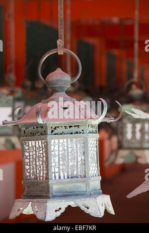 Lanterns at Kasuga Taisha Shrine (UNESCO World Heritage Site) at dusk, Nara, Kansai, Japan - Stock Photo