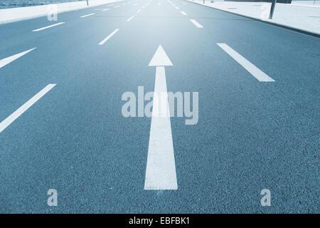 incalculable way, arrow on asphalt - Stock Photo