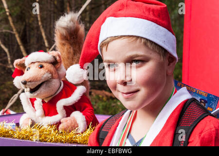 Hundreds of fund-raisers dressed as Santas cycled and ran in the annual 'Santa Dash' to raise money for the Thames - Stock Photo