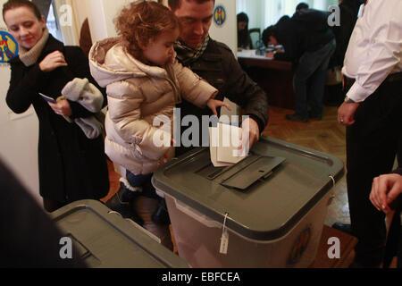 Bucharest, Romania. 30th Nov, 2014. Moldovan citizens vote at the Moldova' s Embassy in Bucharest, capital of Romania, - Stock Photo