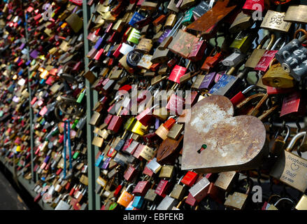Love locks on the railing of the Hohenzollern Bridge in Cologne, NRW, Germany - Stock Photo
