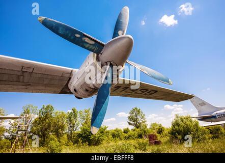 SAMARA, RUSSIA - MAY 25, 2014: Turbines of turboprop aircraft An-12 at an abandoned aerodrome. The Antonov An-12 - Stock Photo