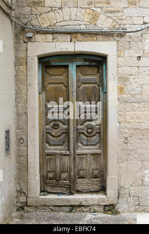 An old wooden door in Castelluccio Valmaggiore a province of Foggia in Italy - Stock Photo