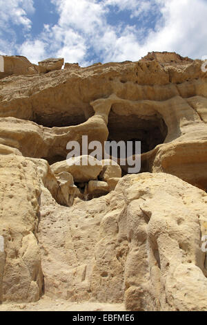 Matala on the Greek island of Crete has become famous for the artificial caves, carved into the rocks. Tombs found - Stock Photo