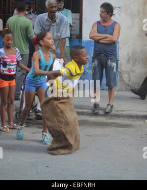 Children participate in a school sports day, on the streets of Centro Habana, Havana, Cuba - Stock Photo