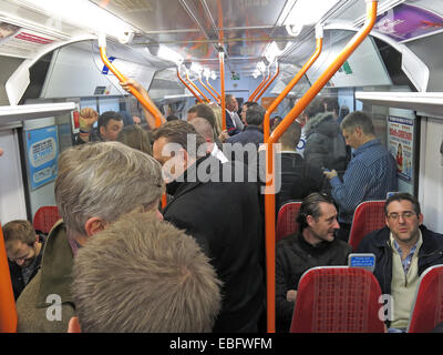 Overcrowded South West Train bound for London Waterloo railway station, England, UK - Stock Photo