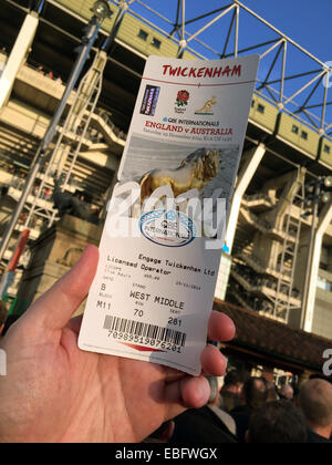 Holding an entrance ticket up at English Rugby at Twickenham, London, England, UK - Stock Photo