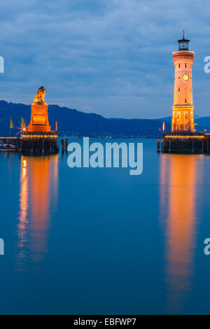 View of harbor entrance and lighthouse at night in Lindau at lake Constance, Bavaria, Germany - Stock Photo