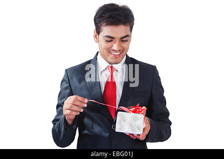 indian Business Man with gift - Stock Photo