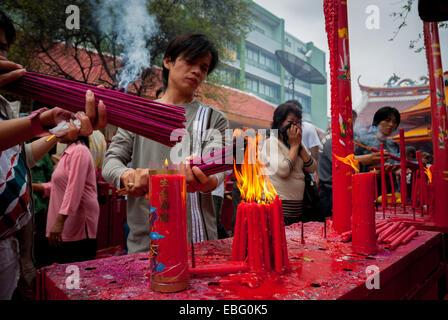 People burn incense sticks during Chinese New Year ritual in Jakarta. © Reynold Sumayku - Stock Photo