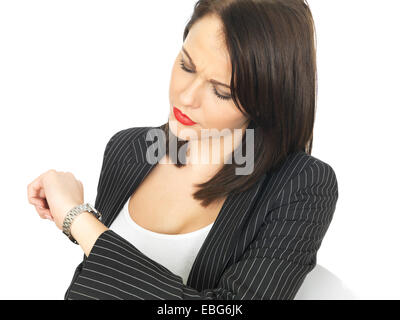 Attractive Business Woman Checking the Time on Her Watch - Stock Photo