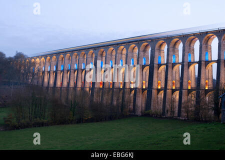 3-SECOND TIME EXPOSURE OF A TRAIN ON A VIADUCT. LED lights illuminate the 2nd & 3r floor. Chaumont, Haute-Marne, - Stock Photo