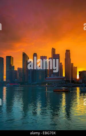 Singapore cityscape at sunset - Stock Photo