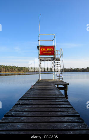 Jetty with a life guard tower of the DLRG, German Life Saving Association, at a swimming lake, Großer Bullensee - Stock Photo