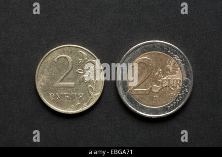 two rubles and two euros coins - Stock Photo