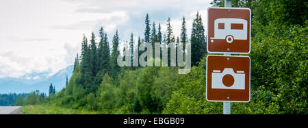 RV and photography sign on scenic highway in Alaska - Stock Photo