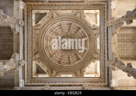 Interior hall with ornate pillars and ceilings in the marble temple, Adinatha Temple, temple of the Jain religion, - Stock Photo