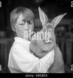 Boy with rabbit (flemish giant) at State Fair in Alaska - Stock Photo